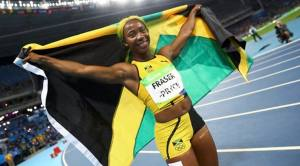 2016 Rio Olympics - Athletics - Final - Women's 100m Final - Olympic Stadium - Rio de Janeiro, Brazil - 13/08/2016. Shelly-Ann Fraser-Pryce (JAM) of Jamaica celebrates after winning the bronze medal after the 100m womens final. REUTERS/Kai Pfaffenbach FOR EDITORIAL USE ONLY. NOT FOR SALE FOR MARKETING OR ADVERTISING CAMPAIGNS.